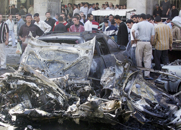 Car bomb Targets Iraqi Police in Baghdad BAGHDAD, IRAQ - OCTOBER 23:  Damaged cars are seen at the site of a car bomb explosion on October 23, 2005 in Baghdad, Iraq. A suicide car bomb exploded in central Baghdad killing two policemen and two civilians and injuring 13 according to the Iraqi police.  (Photo by Akram Saleh/Getty Images)  -- Image Date: 23/10/2005  -- Image Date: 23/10/2005