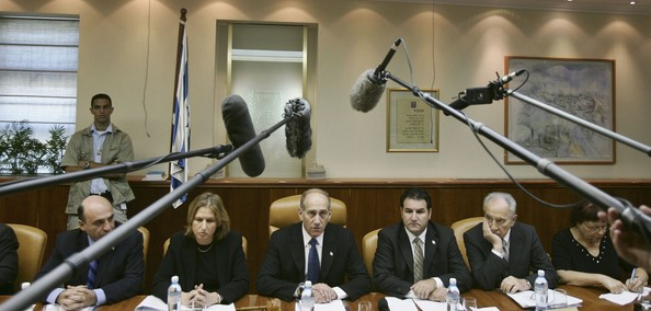 JERUSALEM, ISRAEL - AUGUST 13:  Israeli Prime Minister Ehud Olmert (C) Foreign Minister Tzipi Livni (2nd-L) Deputy Prime Minister and Minister of Transportation Shaul Mofaz (L) Cabinet Secretary Yisrael Maimon (3rd-R) and Vice Premier Shimon Peres (2nd-R) and an unidentified official (R) attend the weekly cabinet meeting on August 13, 2006 in Jerusalem, Israel. As fighting in southern Lebanon continued UN Secretary General Kofi Annan announced that a ceasefire agreement between Israel and Hezbollah is due to take effect on August 14. (Photo by Ronen Zvulun- Pool/Getty Images)  -- Image Date: 8/13/2006  -- Image Date: 8/13/2006
