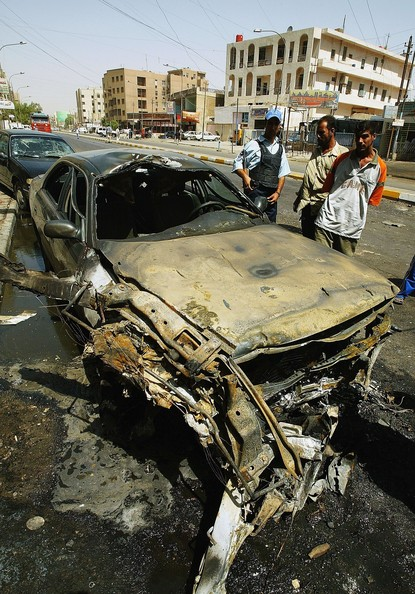BAGHDAD, IRAQ - AUGUST 30:  Iraqis look over the scene of a car bomb explosion on August 30, 2006 in Baghdad, Iraq. A car bomb and a roadside bomb exploded targeting a police patrol in Baghdad killing three civilians and injuring 14 others. Further bomb attacks across Iraq claimed the lives of at least 39 people. (Photo by Wathiq Khuzaie/Getty Images)  -- Image Date: 8/30/2006  -- Image Date: 8/30/2006