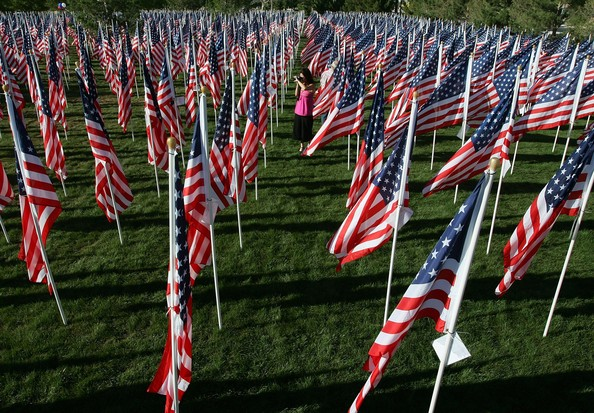 LAS VEGAS - SEPTEMBER 10:  Debbie Pierce of Las Vegas takes photos in the Healing Field, a tribute to the victims of the September 11, 2001, terrorist attacks on the United States at Palm Mortuary September 10, 2006 in Las Vegas, Nevada. The memorial includes 3,000 eight-foot tall American flags, one for each victim of the attacks, and will be on display until September 14, 2006.  (Photo by Ethan Miller/Getty Images)  -- Image Date: 9/10/2006  -- Image Date: 9/10/2006