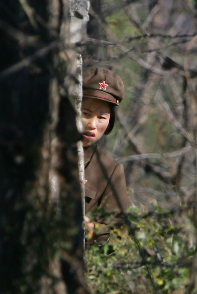 UIJU, NORTH KOREA - OCTOBER 17:  A North Korean border guard looks on near the banks of the Yalu River, opposite the Chinese border city of Dandong on October 17, 2006 in Uiju, Democratic People's Republic of Korea. China has urged North Korea not to escalate international tensions, after Pyongyang said the UN resolution imposing sanctions over its nuclear weapons test was a