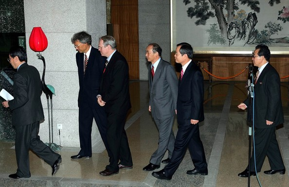 BEIJING - DECEMBER 22:  International negotiators (L-R) Chinese Vice Foreign Minister Wu Dawei, Russian Ambassador to China Sergey Razov, U.S. Assistant Secretary of State Christopher Hill, Japanese chief envoy Kenichiro Sasae, South Korean chief negotiator Chun Yung-woo, and North Korea's Kim Kye Gwan walk off after making a closing statement after five days of six-party talks on North Korea's nuclear program December 22, 2006  in Beijing, China. The first international talks on North Korea's nuclear program since the communist nation tested an atomic bomb ended today with Pyongyang vowing to bolster its arsenal in response to U.S. pressure. The six-party negotiations involve North Korea, the U.S., China, South Korea, Japan and Russia.  (Photo by Greg Baker-Pool/Getty Images)  -- Image Date: 12/22/2006  -- Image Date: 12/22/2006