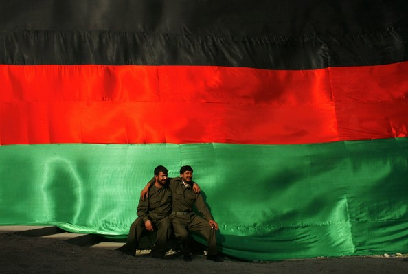 Afghanistan Celebrates 88th Anniversary Of Independence From British Rule: KABUL, AFGHANISTAN - AUGUST 19:  Afghan security guards pose beside a large Afghanistan flag as the country celebrates Independence day, on August 19, 2007 in Kabul, Afghanistan. Afghanistan has marked the 88th anniversary of its independence from British rule, celebrating the signing of the treaty of Rawalpindi in 1919. President Hamid Karzai said today that Afghanistan is once again threatened by a resurgent Taliban-led insurgency.  (Photo Paula Bronstein/Getty Images)  -- Image Date: 8/19/2007