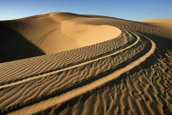 US Waives Laws To Accelerate Completion Of Border Fence: EL CENTRO, CA - APRIL 05:  Tracks are left in the sand in the Colorado Desert at the Imperial Sand Dunes, also known as the Algodones Dunes, along the US-Mexico border on April 5, 2008 between El Centro, California and Yuma, Arizona. In an aggressive move to further extend walls and fences on the border with Mexico, the Bush administration will ignore more than 30 federal laws designed to protect the environment and cultural heritage in order to complete of 670 miles of barriers before the president leaves office. Congress has given US Department of Homeland Security (DHS) Secretary Michael Chertoff the power to waive the federal laws for rapid construction without delays for environmental impact studies and hearings. Two waivers allowing the DHS to ignore the laws are the most expansive to date, encompassing 470 miles of land across California, New Mexico, Arizona and Texas. Conservative Republicans are praising the time-saving tactic but wildlife and conservation groups are reacting with dismay that pristine natural lands, wildlife, and cultural sites could suffer without protective oversight.  (Photo by David McNew/Getty Images)  -- Image Date: 4/5/2008