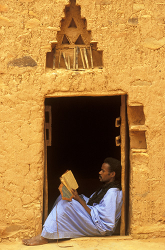 Mohamed Mahmoud, curator of the Hamoni Library in Chinguetti, Mauritania, reading an old Koran.