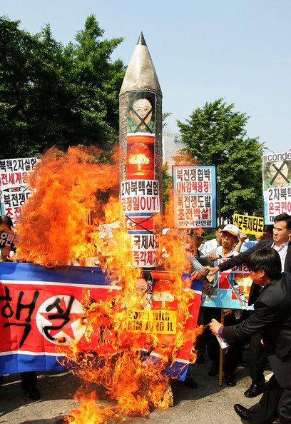 North Korea Conducts Nuclear Test: SEOUL, SOUTH KOREA - MAY 25:  South Koreans burn North Korean flags and a mockup of a North Korean missile during their rally on May 25, 2009 in Seoul, South Korea. North Korea has announced that it successfully conducted a second nuclear test, raising the stakes in the international effort to get the nation to give up its nuclear weapons program. (Photo by Chung Sung-Jun/Getty Images)