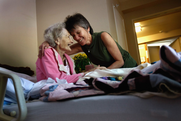 Hospice Cares For Terminally Ill During Final Stage Of Life: LAKEWOOD, CO - AUGUST 21:  Massage therapist Nikki Hernandez embraces terminally ill patient Jackie Beattie, 83, following a massage at the Hospice of Saint John on August 21, 2009 in Lakewood, Colorado. The non-profit hospice, which serves on average 200 people at a time, is the second oldest hospice in the United States. The hospice accepts patients, regardless of their ability to pay, although most are covered by Medicare or Medicaid. The goal of the center is to maintain quality of life, manage pain, and offer spirutal guidance for residents in the last stage of their lives. End of life care has become a contentious issue in the current national debate on health care reform.  (Photo by John Moore/Getty Images)