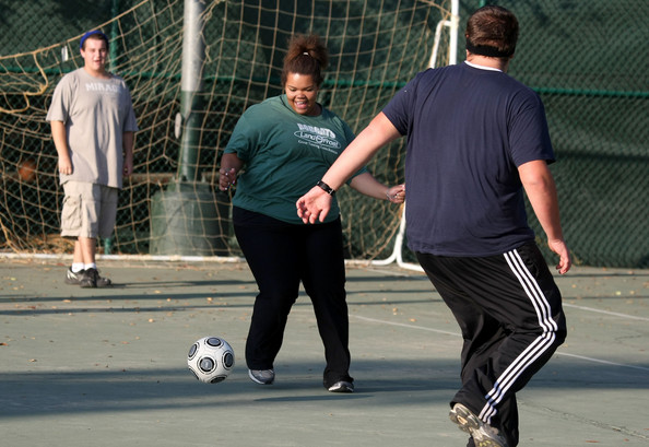 Special School Helps Teen Combat Childhood Obesity: REEDLEY, CA - OCTOBER 20:  Seventeen year-old Marissa Hamilton plays soccer during fitness training at Wellspring Academy October 20, 2009 in Reedley, California. Struggling with her weight, seventeen year-old Marissa Hamilton enrolled at the Wellspring Academy, a special school that helps teens and college level students lose weight along with academic courses. When Marissa first started her semester at Wellspring she weighed in at 340 pounds and has since dropped over 40 pounds of weight in the first two months of the program. According to the Centers for Disease Control and Prevention, 16 percent of children in the US ages 6-19 years are overweight or obese, three times the amount since 1980.  (Photo by Justin Sullivan/Getty Images)