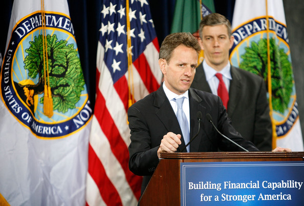 Geithner And Duncan Announce Partnership To Promote Financial Education: WASHINGTON - DECEMBER 15:  U.S. Secretary of the Treasury Timothy Geithner (L) speaks as Secretary of Education Arne Duncan (R) listens during an event to announce a partnership to promote financial education among the nation?s youth December 15, 2009 at the Department of the Treasury in Washington, DC. The Treasury and Education Department are teaming up to bring financial education to classrooms across the country.  (Photo by Alex Wong/Getty Images)