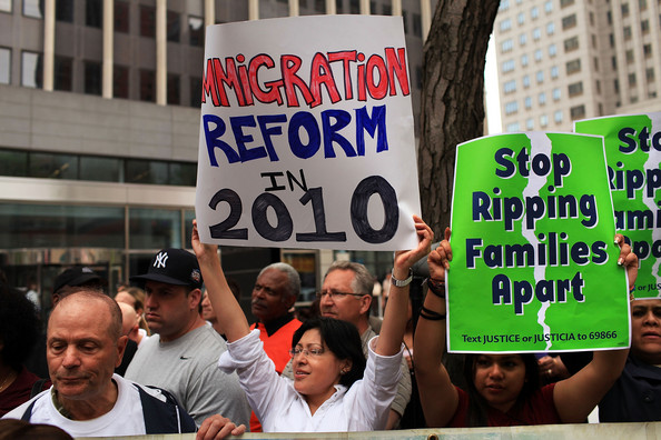 Immigration Activists Protest In New York City: NEW YORK - MAY 17:  People rally before an act of civil disobedience to protest against the lack of an immigration reform bill on May 17, 2010 in New York, New York. Nearly two dozen labor and community leaders, local clergy and City Council members were arrested while stopping traffic in front of 26 Federal Plaza. The protests follow the state of Arizona's passage of a new immigration law which requires individuals suspected of being illegal immigrants to show proof of legal residence when asked by law enforcement. The law has become increasingly divisive, with Mexico's president issuing a travel warning to Mexican citizens in Arizona. Thousands of people have been taking part in similar protests around the country.  (Photo by Spencer Platt/Getty Images)