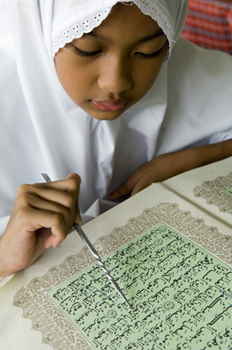 Moslem girls learning to read passages from the Holy Koran.Islamic high school, Brunei Model released (MR3)