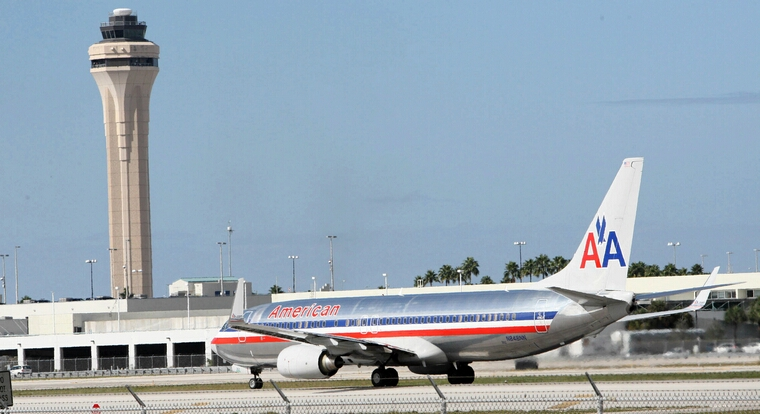 An American Airlines plane arrives to Miami International Airport, Tuesday, November 29, 2011. AMR Corporation, the parent company of American Airlines, said on Tuesday that it had filed for bankruptcy protection in an effort to reduce labor costs and she