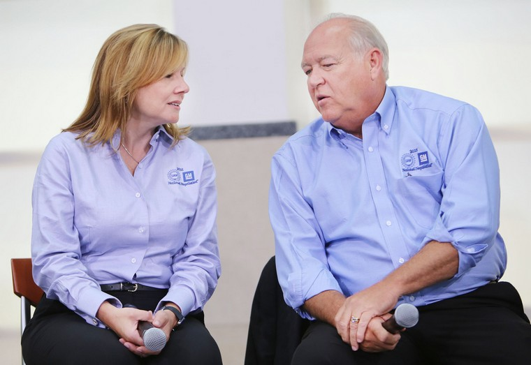 Following the ceremonial handshake between General Motors and United Auto Workers on July 13, 2015, at the UAW-GM Center for Human Resources in Detroit, Mary Barra, Chairman and CEO of General Motors, left, chats with UAW President Dennis Williams as they prepare to take questions from the media. (Regina H. Boone/Detroit Free Press/TNS)
