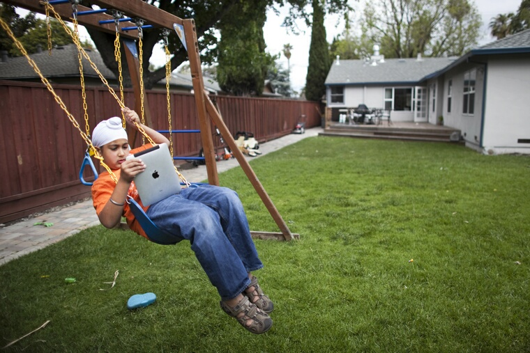 Zoraver Dhillon, 8, plays with his iPad in the backyard in his Redwood City, California, home on May 27, 2010.  Zoraver and his sister, Hazuri, 5, are members of a social networking site called Togetherville, which was founded by their father, Mandeep. (Dai Sugano/San Jose Mercury News/MCT)