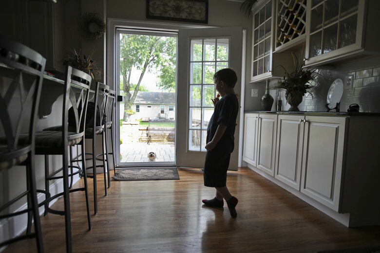 Seven year-old Alex Rowe talks to his dog, Sunny, at home in Landsdale, Pennsylvania, on May 27, 2010. Rowe, who has a rare bleeding disorder, soon will have private health insurance again. He is among more than 5 million Americans under the age of 19 with a pre-existing medical condition who cannot be denied coverage by insurance companies beginning as early as September under a key provision of the health care reform law. (Joseph Kaczmarek/Chicago Tribune/MCT)
