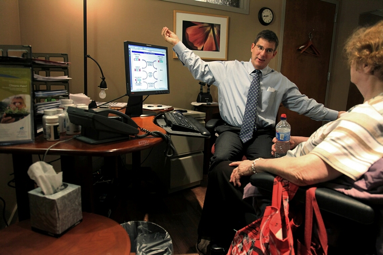 Dr. Greg Plotnikoff talks with patient Bernice Koniar at his office in Minneapolis, Minnesota, in September 2010. Plotnikoff touts the health benefits of Vitamin D for treatment of some conditions. (Elizabeth Flores/Minneapolis Star Tribune/MCT)