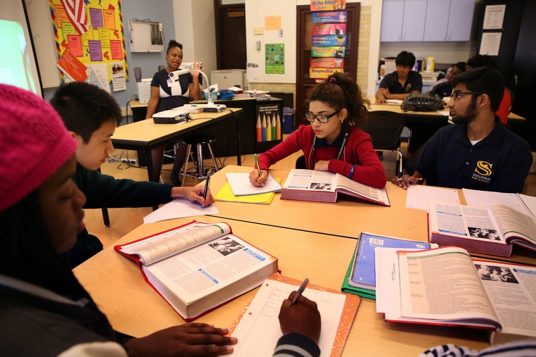Students Muna Biswa, 17, middle and Zayyan Shaikh, 17, right, work during a health science class at Sullivan High School in Chicago on Thursday, Oct.1, 2015. (Nancy Stone/Chicago Tribune/TNS)
