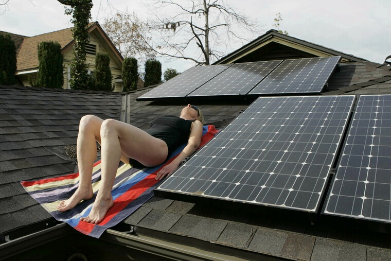 According to the U.S. Department of Energy, about 43 percent of Americans' carbon footprint comes from buildings. Solar-powered electricity is a great option for reducing greenhouse gas emissions, if homeowners can afford it. Incentives through the federal and state government help.  (Don Kelsen/Los Angeles Times/MCT)