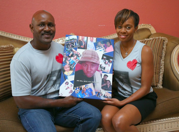 Miami Beach police officers Chris and Shantell Mitchell hold of a picture collage of their late son Dwayne on Friday, Aug. 19, 2016 in Miami. In March, the son of two Miami Beach police officers died from a rare heart condition called Wolff-Parkinson-White Syndrome, which could have been detected by an EKG. The parents have created an organization called the Dwayne Have A Heart Foundation to advocate for all children getting an EKG. (David Santiago/Miami Herald/TNS)