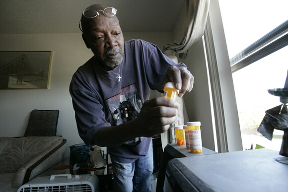 MEDICARE HEALTH COVERAGE: Keith Gresham, 65, lines up four medications he takes at his home in Detroit, Michigan, on October 6, 2011. The self-employed painter was without health insurance for about a decade and was happy to finally reach the age to qualify for medicare. (Patrica Beck/Detroit Free Press/MCT)