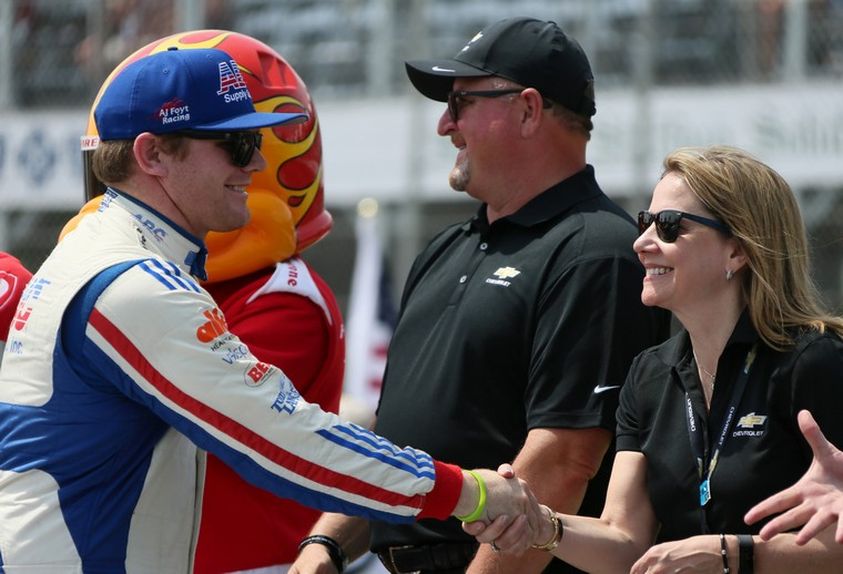 Conor Daly, who drives the ABC Supply Co. Chevrolet for A.J. Foyt Enterprises, shakes hands with Mary Barra, Chairman and CEO of General Motors, during a pre-race ceremony at the Chevrolet Detroit Grand Prix on June 4, 2017. (Mandi Wright/Detroit Free Press/TNS)