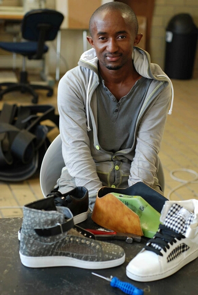 Sifiso Dlamini grew up in Soweto, a South African township, with sneakers and hip-hop. In 2008, he started his own brand of handcrafted sneakers, Eish Hade. Dlamini sells his sneakers in Soweto's major Maponya shopping mall and online. Through social networking, his sneakers have found a niche, with demand mounting into the hundreds. (Robyn Dixon/Los Angeles Times/MCT)