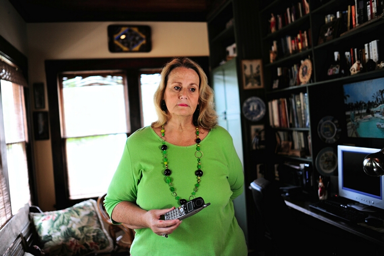 Marlys Cox listens to a tearful voice mail message left to her by a woman who learned of Cox's health care situation and finds herself in a similar situation as she sits for a photograph in her home, Saturday, June 23, 2012, in St. Petersburg, Florida. Cox is in the Affordable Care Act's Pre-existing Condition Insurance Plan (PCIP), a temporary program which extends coverage to more than 67,000 people who can't get private health coverage because of ailments like cancer, diabetes, high blood pressure and asthma. Cox was elated by the high court's decison to uphold the ACA. (Brian Blanco/MCT)