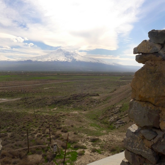 From the ancient monastery where Armenia's patron saint, St. Gregory the Illuminator, spent 13 years in a dungeon, a visitor can see Mt. Ararat in the distance, where Noah's ark came to rest, according to the Book of Genesis, and closer by, the barbed wire fence marking Armenia's border with Turkey. (Roy Gutman/McClatchy/TNS)