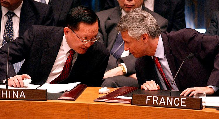 NYP2003021417 - NEW YORK, Feb. 14  (UPI) -- France Foreign Affairs Minister,  Dominique Galouzeau de Villepin and Wang Yingfan, China Ambassador to the UN (left) confer after France informed the UN Security Council on Feb. 14, 2003 that they will not support any council resolution declaring war on Iraq after listening to Hans Blix, Executive Chairman of UNMOVIC outline his agency search of Iraq for weapons of mass destruction.   ep/Ezio Petersen    UPI