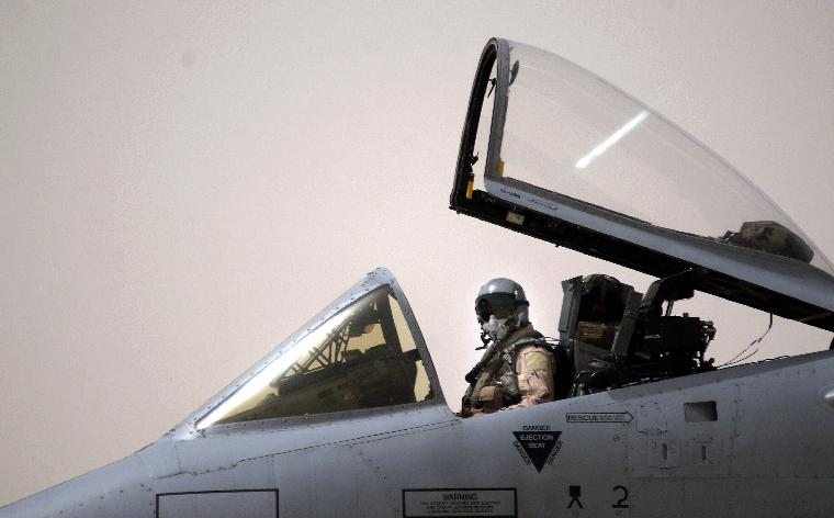 AFF2003040501-Iraq, March 31 (UPI)--  An A-10 pilot from the 392nd Air Expeditionary Wing conducts pre flight checks March 31, 2003, prior to take off on a mission at a forward deployed location in southern Iraq during Operation Iraqi Freedom.  Operation Iraqi Freedom is the multi-national coalition effort to liberate the Iraqi people, eliminate Iraqi's weapons of mass destruction, and end the regime of Saddam Hussein.        jg/Staff Sgt. Shane A. Cuomo/U.S. Air Force