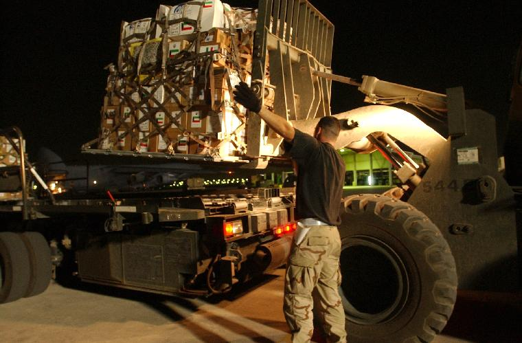 NAV2003041324 - Kuwait City, Kuwait  April 12  (UPI) -- U.S. Air Force personnel load pallets of humanitarian supplies that will be flown to Baghdad to help Iraqi citizens in need. These humanitarian airlifts are a coordinated effort by the people of Kuwait and the U.S. military to deliver aid to the people of Iraq in support of Operation Iraqi Freedom. Operation Iraqi Freedom is the multinational coalition effort to liberate the Iraqi people, eliminate Iraq's weapons of mass destruction and end the regime of Saddam Hussein.   dg/ Arlo K. Abrahamson/U.S. Navy   UPI