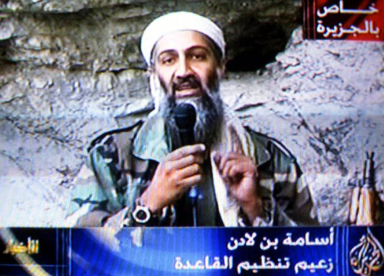 GAZA2001100707- 07 OCTOBER 2001 - GAZA CITY, GAZA: This image taken from video released by Qatar's Al-Jazeera televison broadcast shows Osama bin Laden's delivering his speech, Sunday Oct. 7, 2001, as the United States launched an attack on the Taliban regime in Afghanistan. The tape, which appeared to be pre-recorded, was broadcast by Al Jazeera by satellite throughout the Middle East.  bin Laden said US  would not  live in peace until the Palestinians and Moslems