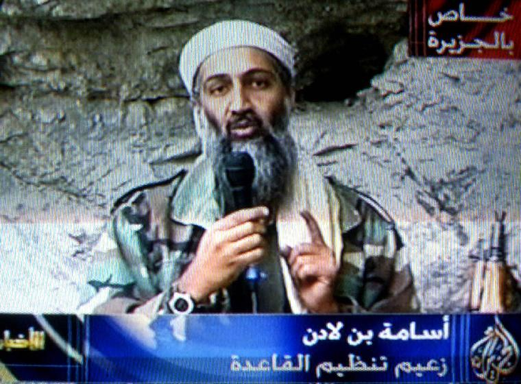 GAZA2001100705 - 07 OCTOBER 2001 - GAZA CITY, GAZA: This image taken from video released by Qatar's Al-Jazeera televison broadcast shows Osama bin Laden's delivering his speech, Sunday Oct. 7, 2001, as the United States launched an attack on the Taliban regime in Afghanistan. The tape, which appeared to be pre-recorded, was broadcast by Al Jazeera by satellite throughout the Middle East.  bin Laden said US  would not  live in peace until the Palestinians and Moslems