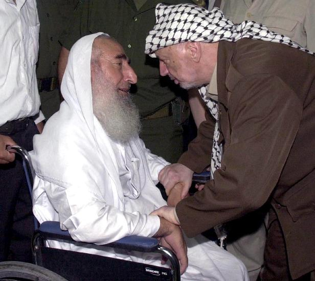 GAZ2001120598 - 05 DECEMBER 2001 - GAZA CITY, GAZA: File Photo - Sheikh Ahmed Yassin, the founder and spiritual leader of the Moslem militant group Hamas,  left, pays his condolences to Palestinian Leader Yasser Arafat at his office in Gaza City, Monday, August 27, 2001. Arafat headed a house morning of Mustafa Zibri. Leader of the PFLP or Popular Front for the Liberation of Palestine Mustafa Zibri, widely known as Abu Ali Mustafa, was killed in Ramallah when the Israeli helicopters fired rockets at his office. Zibri, was the highest-ranking Palestinian official killed in a targeted attack in 14 months of fighting. Palestinian Authority security forces have placed Yassin under house arrest, and is barred from outside contacts, Palestinian security officials said December 5, 2001. The Palestinian President Yasser Arafat  said that he was determined to break the violence networks in the Palestinian territories, but Israeli military strikes and sieges were making the job impossible.