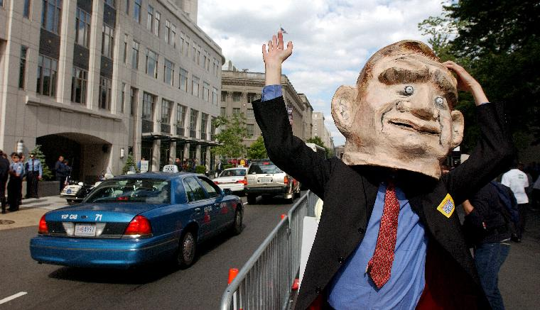 WAP2002052198 - WASHINGTON, May 21 (UPI) -- A person wearing a George W. Bush mask waves at commuters in the streets of Washington while demonstrating against global monetary policies and unfair labor practices on May 21, 2002.    rlw/Roger L. Wollenberg   UPI
