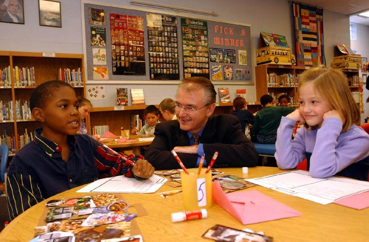 SLP2002111501- BRENTWOOD, Mo., Nov. 15 (UPI) -- Missouri Gov. Bob Holden talks with students Brendon Moody (10) and Molly Fitzgerald (7)  during a visit to the Mark Twain Elementary School in Brentwood, Mo., on Nov. 15, 2002. Holden visited the school to see the school to get a first hand look at the Character Education program, in which older students are paired with younger ones. holden says the older students serve as role models and can assist the younger ones with questions and problems they may have. The State of Missouri has just received a four-year, $2 million federal grant to expand the character education programs in public schools.       rlw/bg/Bill Greenblatt        UPI