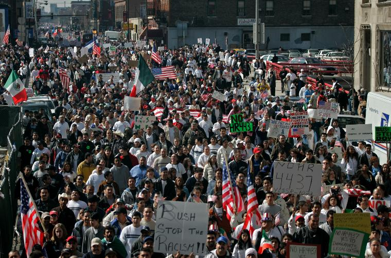 TENS OF THOUSANDS PROTEST HR 4437 IN CHICAGO: Tens of thousands march through the streets of Chicago in protest of HR 4437, the Border Protection, Antiterrorism, and Illegal Immigration Control Act of 2005, on March 10, 2006. The bill before Congress in part makes it a criminal act to help illegal immigrants. (UPI Photo/Brian Kersey)