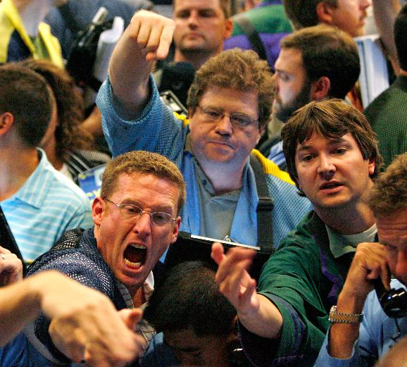 Stocks collapse in the wake of the government bailout of AIG: Traders work in the S&P 500 options pit at the Chicago Board Options Exchange on September 17, 2008 in Chicago. The S&P 500 closed down 57 points at 1,156.39 and the Dow lost nearly 450 points closing at 10,609.66 amid investor anxieties about the financial system following the government's bailout of insurer American International Group, Inc. on Tuesday. (UPI Photo/Brian Kersey)