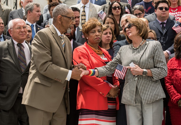 Rep. Bobby Rush (D-IL), left, who lost a son to gun violence, shakes hands with House Minority Leader Nancy Pelosi (D-CA), right, at a press conference urging Speaker Ryan and the House Republicans to take up gun reform legislation before leaving on recess, at the U.S. Capitol Building in Washington, D.C. on June 22, 2016. The House Democrats staged a sit-in on the House floor in an attempt to force a House gun control vote. Photo by Ken Cedeno/UPI