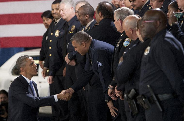 President Barack Obama Promotes National Gun Control Legislation in Denver: President Barack Obama encourages Congress passing national gun control laws during a speech at the Denver Police Academy on April 3, 2013 in Denver.  Some Denver police officers are concerned about being used in the background during Obama's speech.     UPI/Gary C. Caskey
