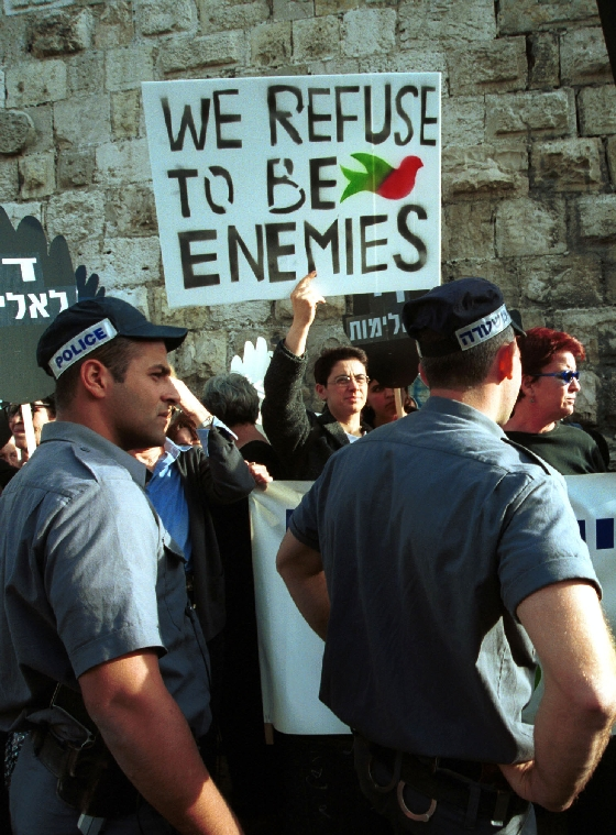 JER2000122906 - 29 DECEMBER 2000 - JERUSALEM, ISRAEL:  Israeli  police look at Israeli and Palestinian demonstrators at the 1967 border of the Old City of Jerusalem, December 29, 2000. The protesters called upon Israeli Prime Minister Ehud Barak to dismantle the Jewish settlements in the West Bank and Gaza, stop the occupation of Palestinian areas and accept the U.S. proposal that would make Jerusalem the shared capital of both Palestine and Israel.   bc/dh/Debbie Hill UPI
