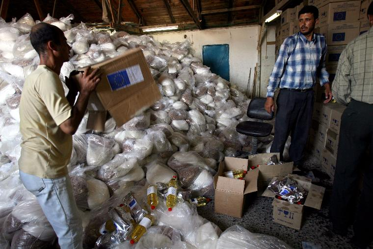 UNITED NATIONS DISTRIBUTES FOOD TO PALESTINIANS: Palestinians receive food supplies from the United Nations in Gaza City, June 18, 2006. The United Nations agency has begun to distribute basic food to some 90,000 government workers and their dependents in response to a deteriorating humanitarian situation in the Gaza Strip, United Nations officials said. Many government employees have not received salaries in nearly four months. (UPI Photo/Ismael Mohamad)