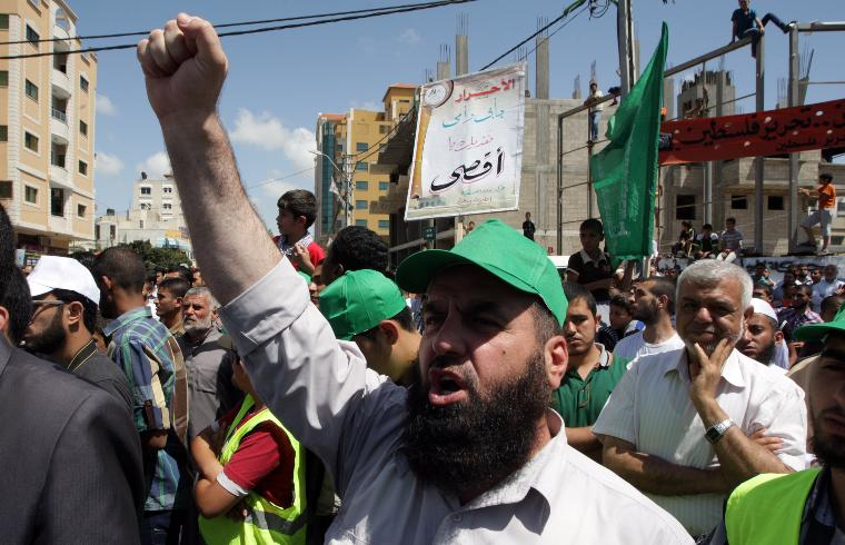 Palestinians Commemorate the 47th Naksa Anniversary.: Palestinian men chant slogans during demonstration, as they mark 'Naksa Day' in Gaza City on June 6, 2014. Naksa Day (setback) is the annual day of commemoration for the Palestinian people of the displacement that accompanied Israel's victory in the 1967 Six-Day War. As a result of the war, Israel took control of the Palestinian-populated West Bank,East Jerusalem  and Gaza Strip, which were previously annexed by Jordan and controlled by Egypt, respectively. UPI/Ismael Mohamad