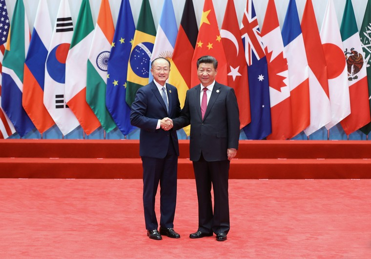 Chinese President Xi Jinping (R) welcomes World Bank President Jim Yong Kim to the opening ceremony of the G20 Summit in Hangzhou, the capital of Zhejiang Province, on September 4, 2016.  World leaders have come to China for the start of the G20 Summit, where heads of states will discuss global economics, trade, climate and terrorism issues.      Pool Photo by Ma Zhancheng /UPI