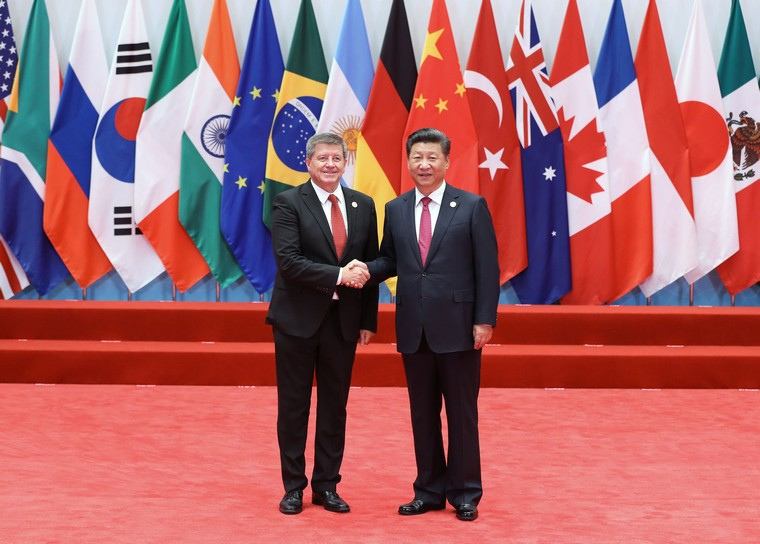 Chinese President Xi Jinping (R) welcomes International Labor Organization (ILO) Director General Guy Ryder to the opening ceremony of the G20 Summit in Hangzhou, the capital of Zhejiang Province, on September 4, 2016.  World leaders have come to China for the start of the G20 Summit, where heads of states will discuss global economics, trade, climate and terrorism issues.      Pool Photo by Ma Zhancheng /UPI