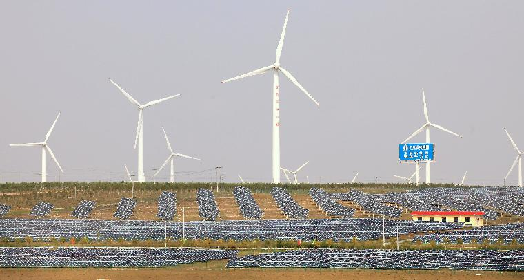 Wind and solar power is generated in the Taiyangshan Development Zone: Both wind turbines and solar panel fields operate in the Taiyangshan Development Zone in Wuzhong, a frontier city in the northwestern province Ningxia Hui Autonomous Region on September 22, 2011.  The 215 square mile zone has the advantages of both strong wind and solar power, resulting in 300 megawatts of wind power and 100 megawatts of photovoltaic power. Taiyangshan is the biggest clean energy base in China. UPI/Stephen Shaver