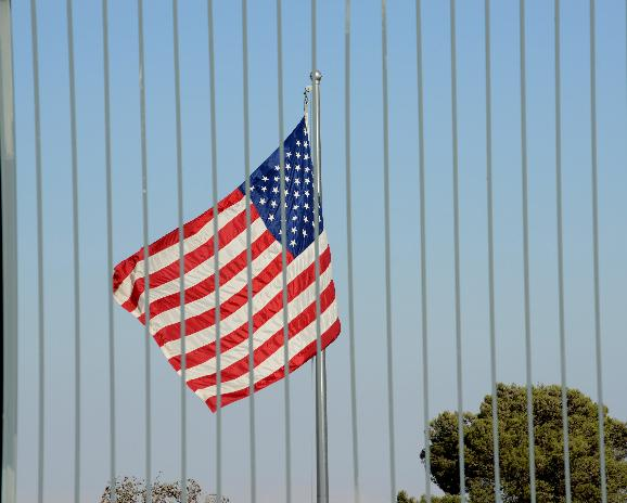 American Flag At United States Consulate Building, Jerusalem: An American flag flies behind a tall fence surrounding  the United States Consulate General building in Jerusalem, Israel, August 3, 2013. The US State Department has announced a plan to close dozens of US Embassies and Consulates in the Middle East and North Africa, including those in Yemen, Egypt, Iraq, Saudia Arabia and Israel on Sunday, after intercepting messages by senior Al-Qaeda members discussing attacks against American targets abroad. The United States has issued a warning to American citizens and travelers to avoid crowded areas.  UPI/Debbie Hill