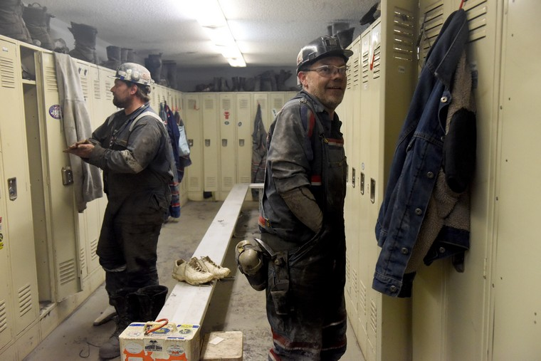 Miners change clothes at the end of their underground shift at the Gateway Eagle Mine, an United Mine Workers mine in Pond Fork, Boone County, in southern West Virginia, March 13, 2016. Coal is a fossil fuel, which has suffered a significant decline in recent years, resulting in price drops and loss of jobs with mines closing. The broad scientific consensus that carbon emissions drive global warming has brought stricter EPA regulations as energy shifts to renewable, cleaner energy. Also the advances in natural gas has made shale gas more economically viable. The price of metallurgical coal used in steel production has gone from $300 a ton to $80 to $90 a ton, while steam or thermal coal used in power generation has gone from $120 a ton to low $40 a ton. Coal production is the most important subject in the upcoming 2016 Presidential election for residents of West Virginia.   Photo by Debbie Hill/ UPI