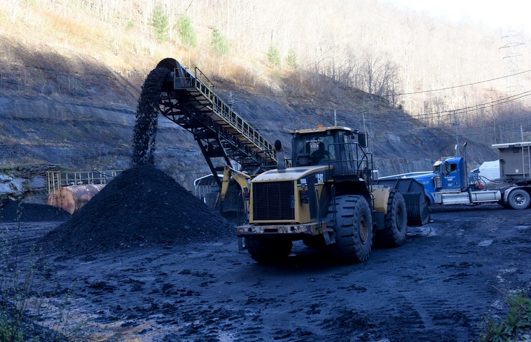 Coal pours off a conveyor belt at the Gateway Eagle Mine, an United Mine Workers mine in Pond Fork, Boone County, in southern West Virginia, March 13, 2016. Coal is a fossil fuel, which has suffered a significant decline in recent years, resulting in price drops and loss of jobs with mines closing. The broad scientific consensus that carbon emissions drive global warming has brought stricter EPA regulations as energy shifts to renewable, cleaner energy. Also the advances in natural gas has made shale gas more economically viable. The price of metallurgical coal used in steel production has gone from $300 a ton to $80 to $90 a ton, while steam or thermal coal used in power generation has gone from $120 a ton to low $40 a ton. Coal production is the most important subject in the upcoming 2016 Presidential election for residents of West Virginia.   Photo by Debbie Hill/ UPI