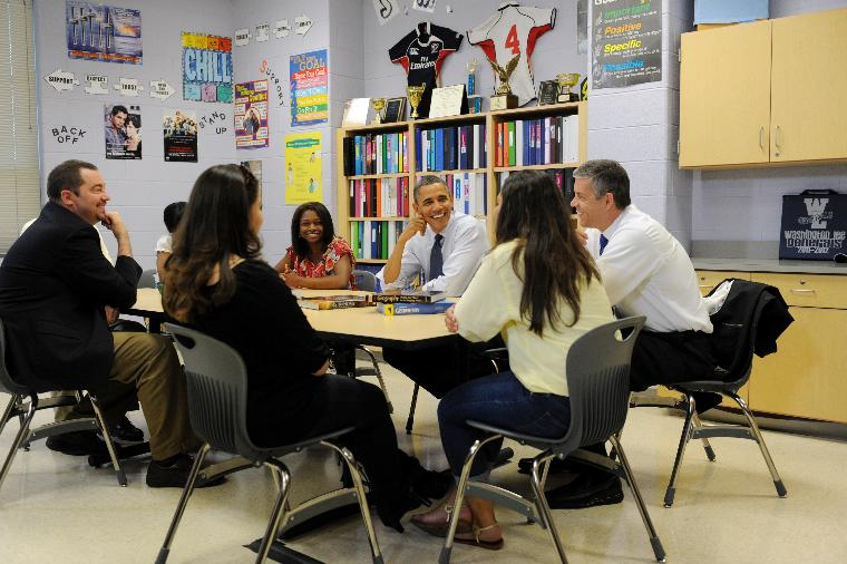 US President Barack Obama: US President Barack Obama (C) and US Secretary of Education Arne Duncan (R) participate in a roundtable discussion on affordable higher education with high school students and their parents, at Washington-Lee High School in Arli